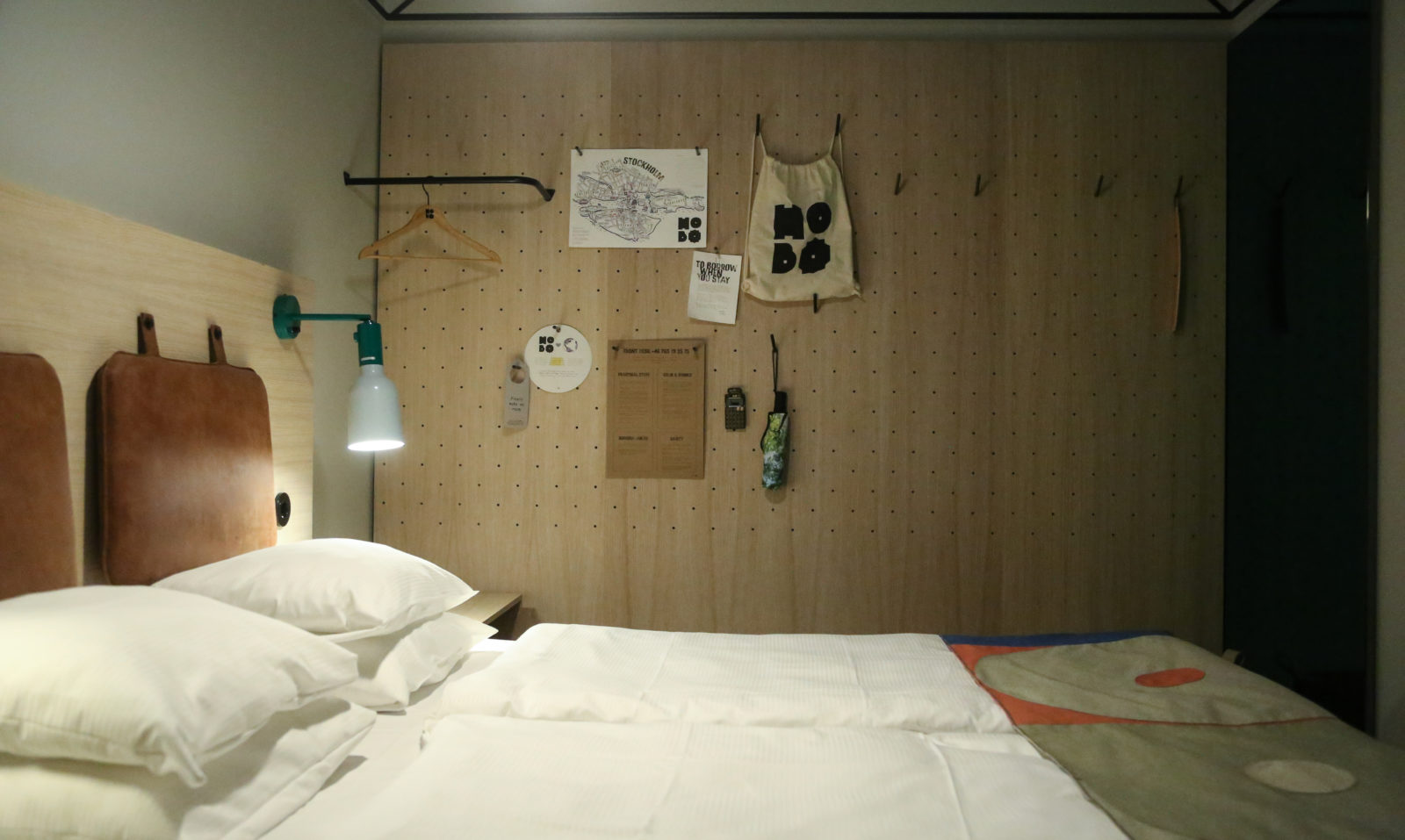 King size bed with white fresh sheets at Hobo Hotel in Stockholm