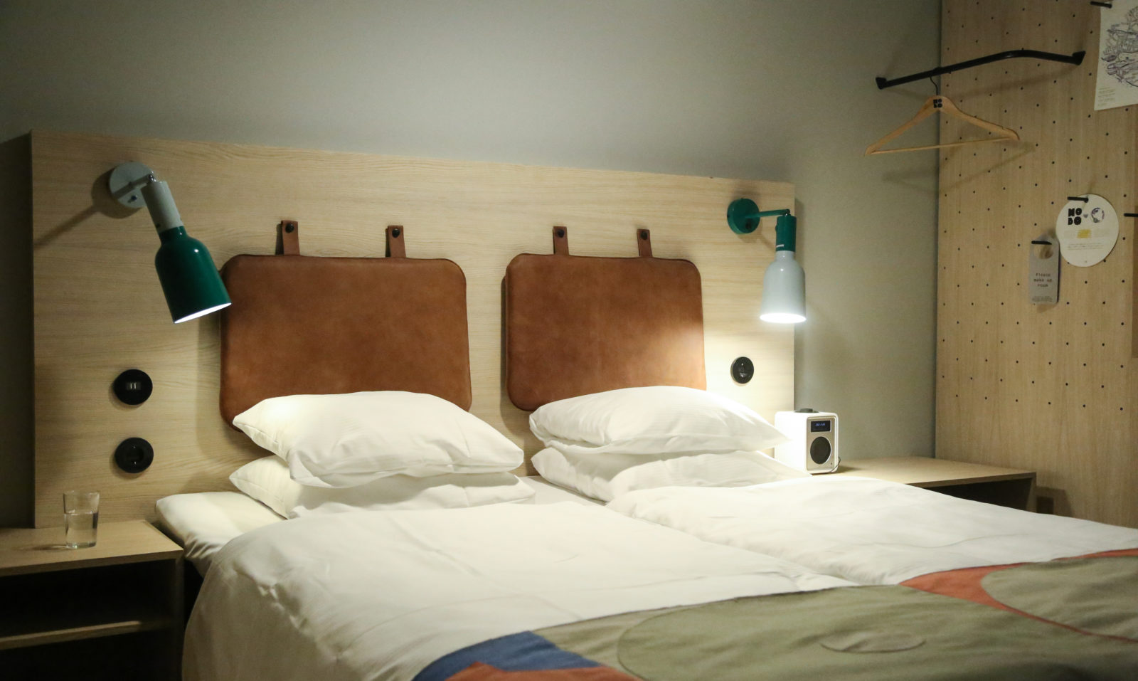 Smaller room with bed with white fresh sheets at Hobo Hotel in Stockholm